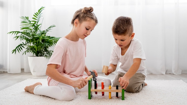 Kids playing with colorful game together Free Photo