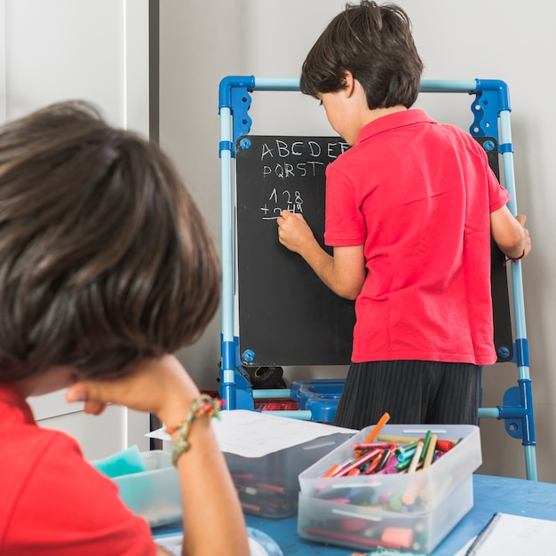 Kids in preschool studying together Free Photo