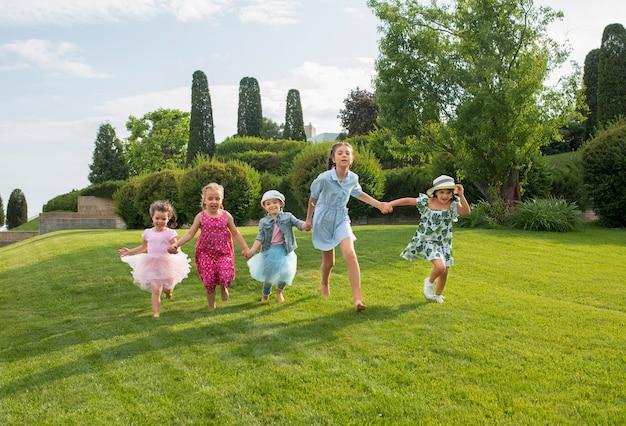 Kids running in the garden Free Photo