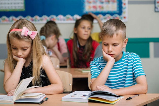 kids studying in classroom photo free download