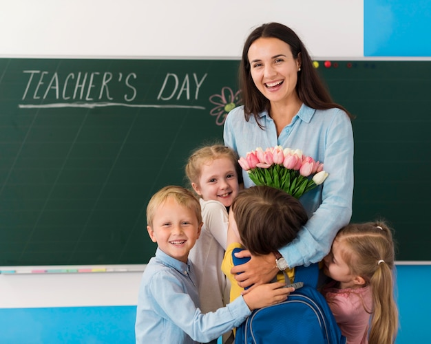 Kids and teacher celebrating teacher's day Free Photo