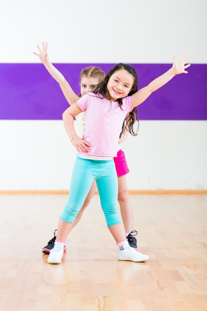 Kids train fitness in dancing school Premium Photo