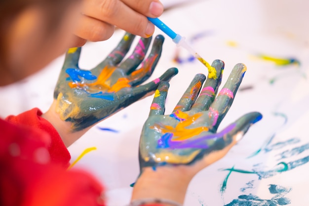kids with dirty painted hand in art classroom photo premium download