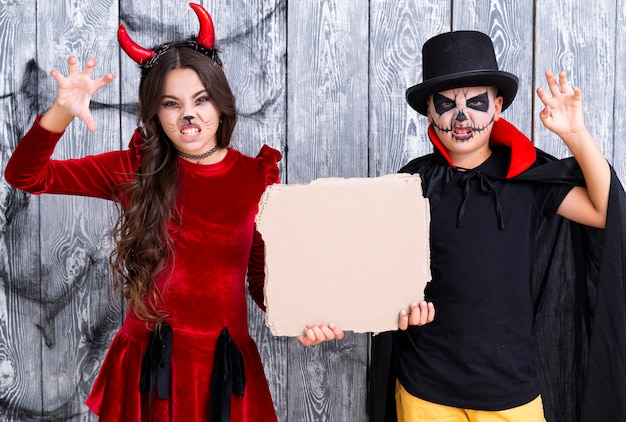 Kids with painted faces ready for halloween Free Photo