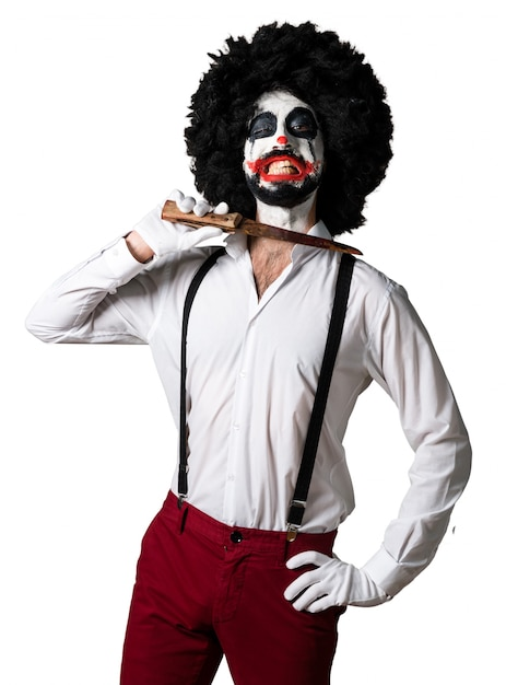 Killer clown with knife making suicide gesture Free Photo