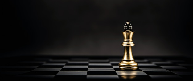 King golden chess is standing on chess board Premium Photo