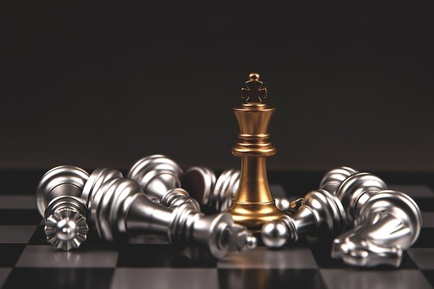 King golden chess standing of the falling silver chess with dark background. Premium Photo