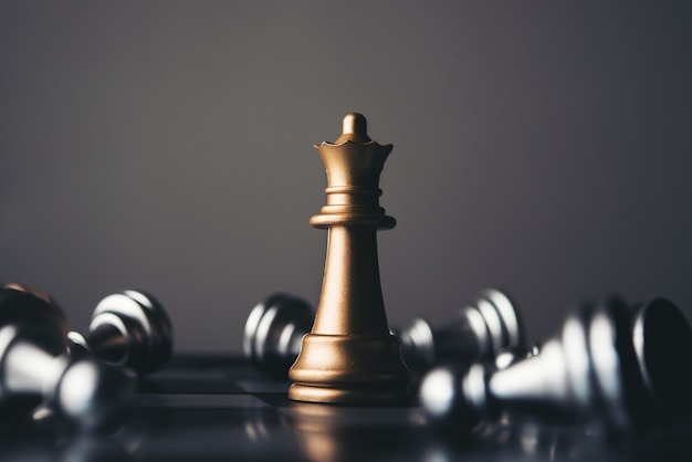 King and knight of chess setup on dark background . Premium Photo