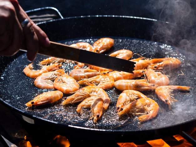 King shrimps frying in oil in pan Free Photo