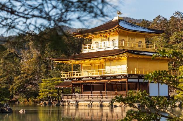 Kinkakuji temple ( rokuon-ji temple ) . golden pavilion at kyoto , japan . telephoto view Premium Photo