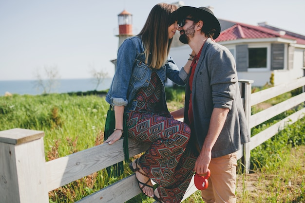 Kissing happy young stylish hipster couple in love kissing Free Photo