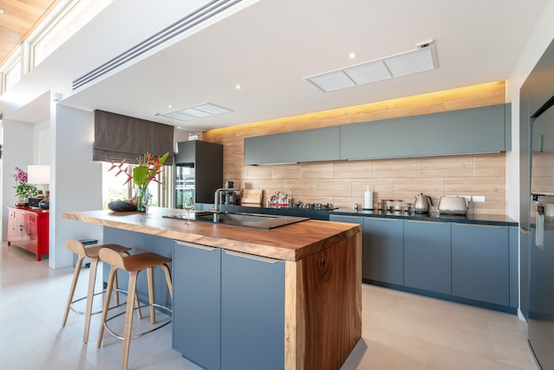 Kitchen area which feature island counter and built in furniture Premium Photo