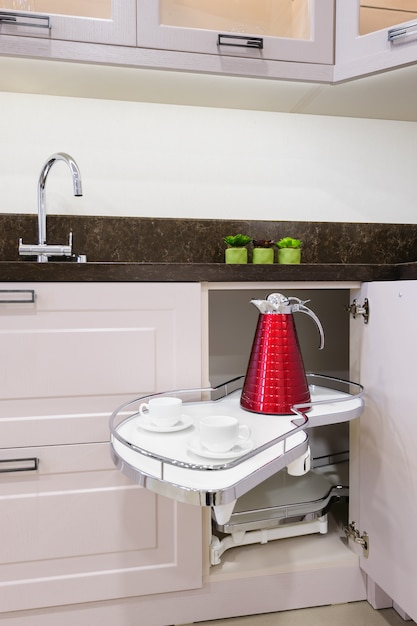 Kitchen corner unit with pullout shelves Premium Photo
