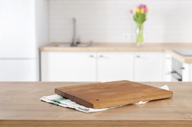 Premium Photo   Kitchen cutting board on the kitchen table ...