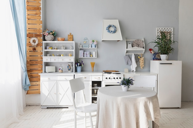 Kitchen and dining room with white furniture Free Photo