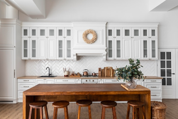 Kitchen interior design with wooden table Free Photo