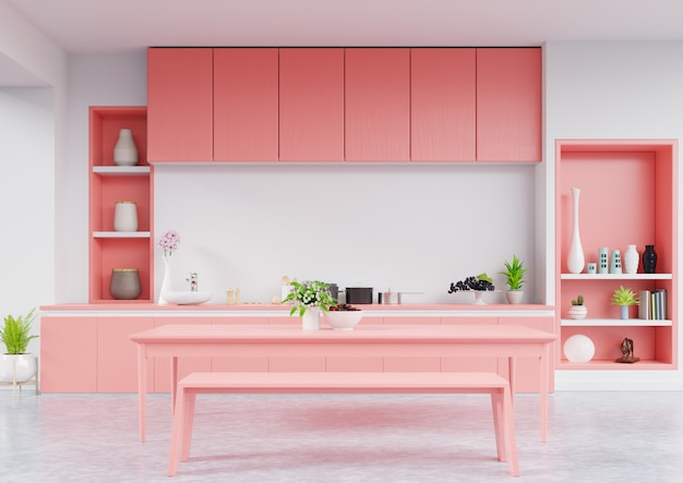 Kitchen interior with living coral color wall Premium Photo