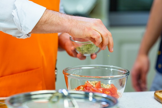 Kitchen preparation: the chef prepares a salad Premium Photo