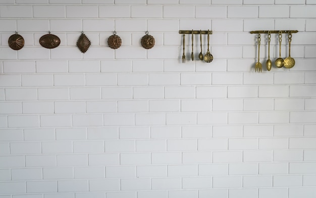 Kitchen spoon and fork hanging on wall Free Photo