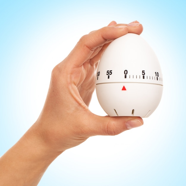 Kitchen timer in woman's hand Free Photo