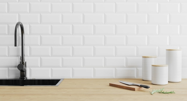 Kitchen utensils gadgets near black sink on wooden surface and white tiled wall Premium Photo