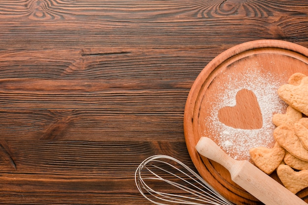 Kitchen utensils with cookies for valentines day Free Photo