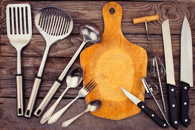 Kitchen utensils on wooden background. Premium Photo