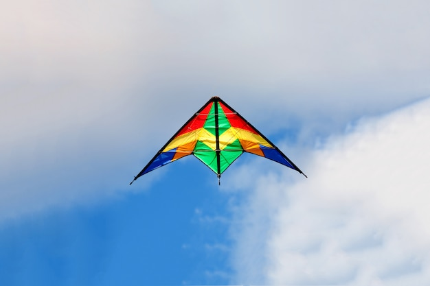 Kite flying on a over blue sky Premium Photo