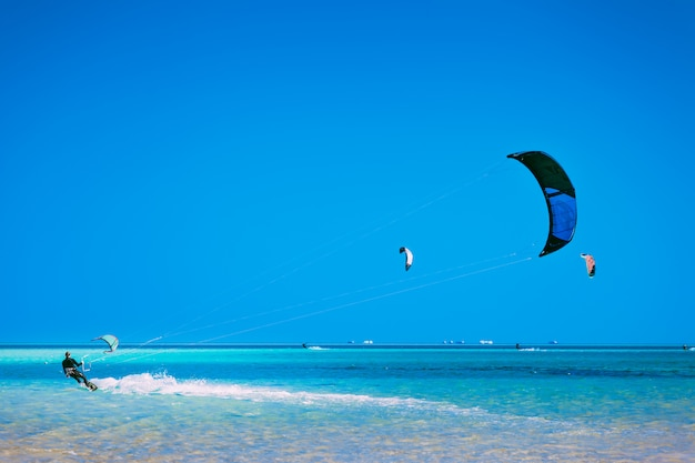Kiter gliding over the red sea surface. Premium Photo