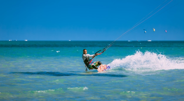 Kitesurfer gliding on the red sea Premium Photo