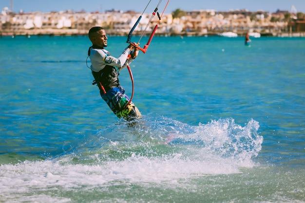 The kitesurfer on the red sea waves. egypt. Premium Photo