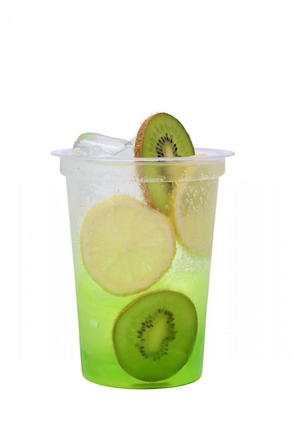 Kiwi and lemon lemonade in plastic take away glass Premium Photo