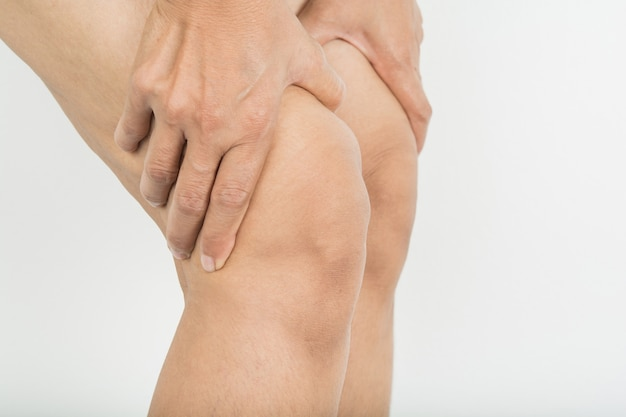 Knee pain in woman Premium Photo