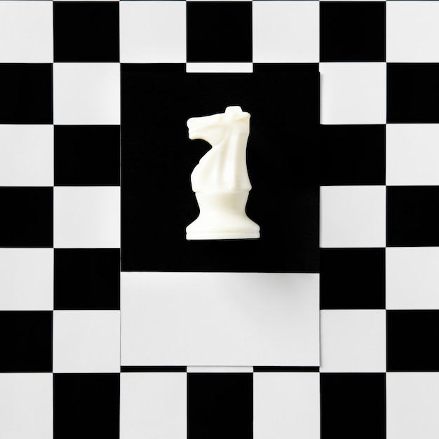 Knight chess piece on a pattern Free Photo