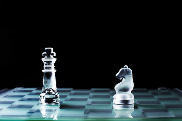 Knight and knight face to face or confrontation of chess game board Free Photo