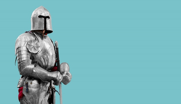 Knight in shiny metal armor. reliable security and insurance. copy space. Premium Photo