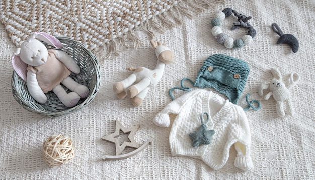 Knitted children's clothing on a light background with accessories Free Photo