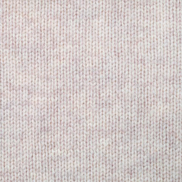 Knitted woollen texture background. plain knitting Premium Photo