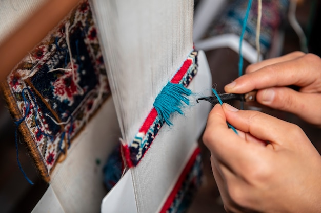 Knitting carpet with blue threads Free Photo