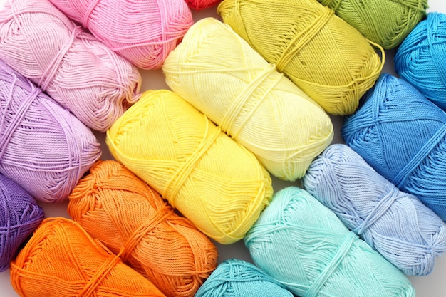 Knitting, close-up. colorful threads on the table Free Photo