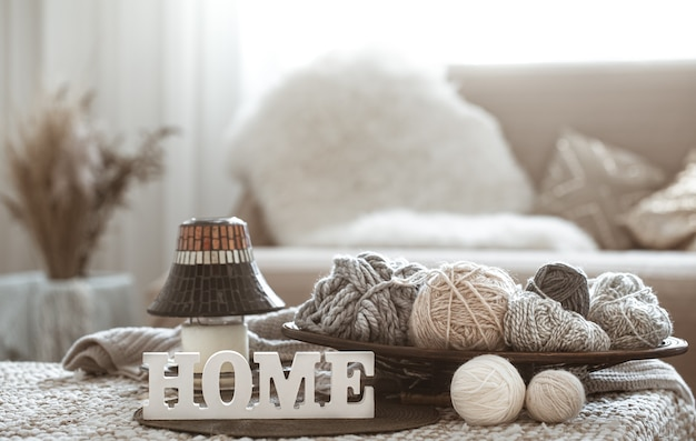 Knitting threads on the table and home wooden letters Free Photo