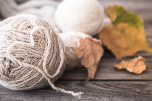 Knitting threads with autumn leaves Premium Photo