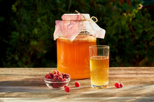 Kombucha is a drink produced by fermenting tea with symbiotic culture of bacteria. Premium Photo