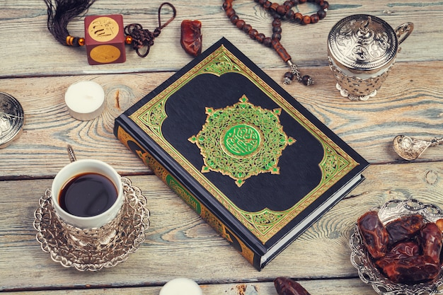 Koran book with dates, coffee and tasbih Premium Photo