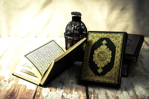 Koran - holy book of muslims ( public item of all muslims ) on the table , still life Premium Photo