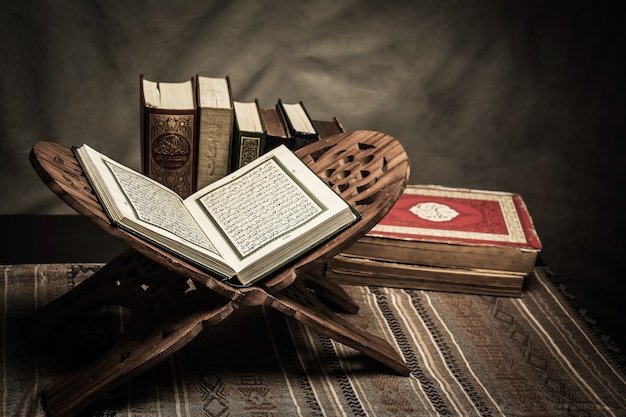 Koran - holy book of muslims ( public item of all muslims ) on the table Premium Photo
