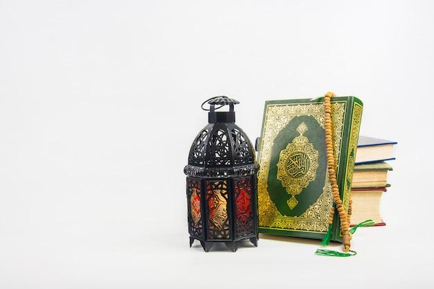 Koran, holy book of muslims with lightened lantern style arab or morocco Premium Photo