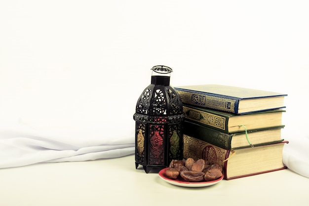 Koran , holy book of muslims with lightened lantern style arab or morocco Premium Photo