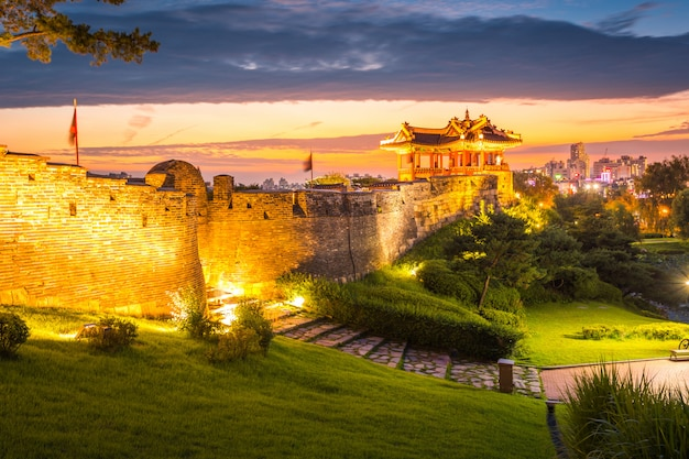 Korea landmark and park after sunset, traditional architecture at suwon, hwaseong fortress in sunset, south korea. Premium Photo