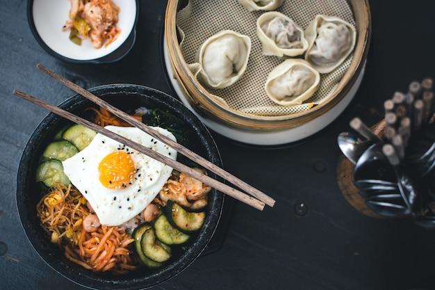 Korean bibimbap and dim sum Free Photo